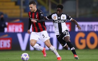 Parma, Italy, 10th April 2021. Diogo Dalot of AC Milan takes on Chaka Traore of Parma Calcio during the Serie A match at Stadio Ennio Tardini, Parma. Picture credit should read: Jonathan Moscrop / Sportimage via PA Images