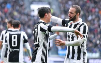 Juventus' Paulo Dybala (L) jubilates with his teammate Gonzalo Higuain after scoring the goal during the Italian Serie A soccer match Juventus FC vs Udinese Calcio at Allianz Stadium in Turin, Italy, 11 March 2018.ANSA/ALESSANDRO DI MARCO