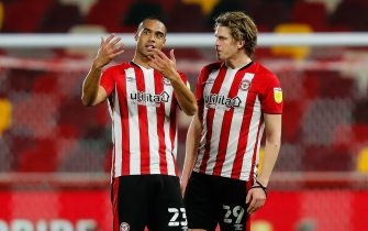 Mads Bech Sørensen of Brentford gets some extra coaching from new signing Winston Reid of Brentford after the Sky Bet Championship match between Brentford and Bristol City at the Brentford Community Stadium, BrentfordPicture by Mark D Fuller/Focus Images/Sipa USA 03/02/2021