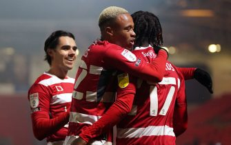 Doncaster Rovers' Taylor Richards (right) celebrates scoring their side's second goal of the game during the Sky Bet League One match at the Keepmoat Stadium, Doncaster. Picture date: Tuesday January 26, 2021.