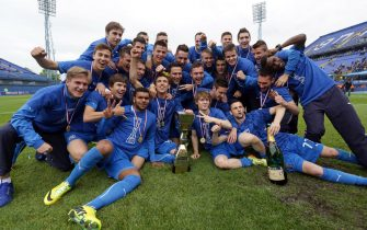 ZAGREB,CROATIA - MAY 17:  Dinamo Zagreb's players celebrate with the trophy after the Croatian Prva HNL Liga match between FC Dinamo Zagreb and FC Hajduk Split at the Maksimir Stadium on May. 17, 2014 in Zagreb, Croatia. (Photo by Damir Sencar/EuroFootball/Getty Images)