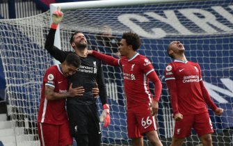 epa09204960 Liverpool's goalkeeper Alisson (2-L) celebrates with teammates after scoring the 2-1 lead during the English Premier League soccer match between West Bromwich Albion and Liverpool FC in West Bromwich, Britain, 16 May 2021.  EPA/Rui Vieira / POOL EDITORIAL USE ONLY. No use with unauthorized audio, video, data, fixture lists, club/league logos or 'live' services. Online in-match use limited to 120 images, no video emulation. No use in betting, games or single club/league/player publications.