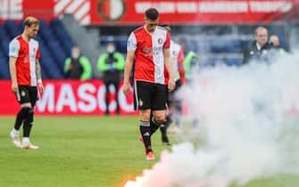 epa09204608 Supporters of Feyenoord throw flares onto the pitch during the Dutch Eredivisie soccer match between Feyenoord Rotterdam and RKC Waalwijk at the Kuip in Rotterdam, Netherlands, 16 May 2021.  EPA/Pieter Stam de Jonge