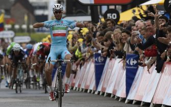 Italy's Vincenzo Nibali celebrates as he crosses the finish line at the end of the 201 km second stage of the 101st edition of the Tour de France cycling race on July 6, 2014 between York and Sheffield, northern England.  AFP PHOTO / ERIC FEFERBERG        (Photo credit should read ERIC FEFERBERG/AFP via Getty Images)