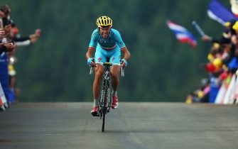 LA PLANCHE DES BELLES FILLES, FRANCE - JULY 14:  Vincenzo Nibali of Italy and the Astana Pro Team crosses the finish line to win stage ten of the 2014 Tour de France, a 162km stage between Mulhouse and La Planche des Belles Filles, on July 14, 2014 in La Planche des Belles, France.  (Photo by Bryn Lennon/Getty Images)