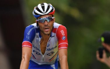 epa08601451 French rider Thibaut Pinot of Groupama-FDJ team crosses the finish line during the 2nd stage of the Criterium du Dauphine cycling race over 135km between Vienne and Col de Porte, France, 13 August 2020.  EPA/JUSTIN SETTERFIELD/POOL