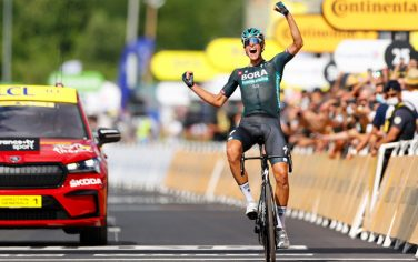 Stage winner Team Bora Hansgrohe's Nils Politt of Germany celebrates as he crosses the finish line at the end of the 12th stage of the 108th edition of the Tour de France cycling race, 159 km between Saint-Paul-Trois-Chateaux and Nimes, on July 8, 2021. (Photo by Thomas SAMSON / AFP) (Photo by THOMAS SAMSON/AFP via Getty Images)