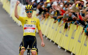 Team UAE Emirates' Tadej Pogacar of Slovenia wearing the overall leader's yellow jersey  celebrates as he crosses the finish line during the 18th stage of the 108th edition of the Tour de France cycling race, 129 km between Pau and Luz Ardiden, on July 15, 2021. (Photo by Thomas SAMSON / AFP) (Photo by THOMAS SAMSON/AFP via Getty Images)
