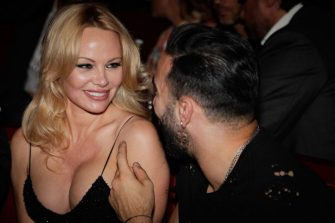 """US actress Pamela Anderson (L) and Marseille's French defender Adil Rami (R) attend the Premiere of the new show """"Bionic ShowGirl"""" at the """"Crazy Horse"""" cabaret on June 3, 2019 in Paris. (Photo by Geoffroy VAN DER HASSELT / AFP)        (Photo credit should read GEOFFROY VAN DER HASSELT/AFP via Getty Images)"""