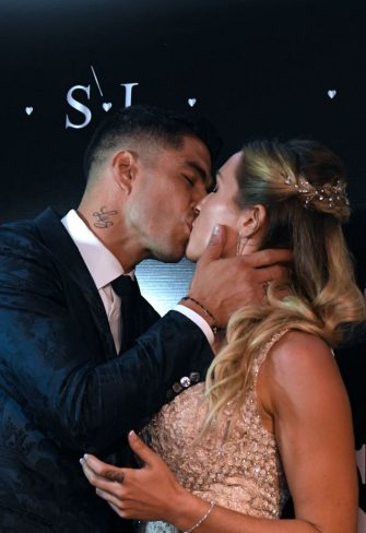 Uruguayan Barcelona forward Luis Suarez kisses his wife Sofia Balbi upon their arrival at a party for the renewal of their marriage vows in La Barra, near Punta del Este, Uruguay, on December 26, 2019. (Photo by EITAN ABRAMOVICH / AFP) (Photo by EITAN ABRAMOVICH/AFP via Getty Images)