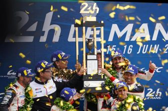 epa07652047 Sebastien Buemi of Switzerland, Kazuki Nakajima of Japan and Fernando Alonso of Spain, drivers of Toyota Gazoo Racing (starting no.8) in a Toyota TS050 Hybrid celebrate on the podium after winning the Le Mans 24 Hours race in Le Mans, France, 16 June 2019.  EPA/EDDY LEMAISTRE
