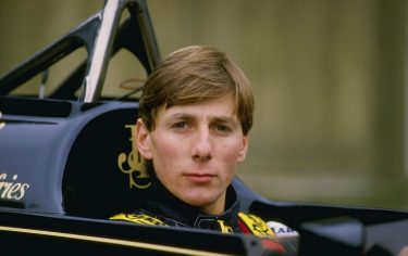 Racing driver Johnny Bute, Marquess of Bute aka Johnny Crichton-Stuart and Johnny Dumfries driver of the #11 John Player Special Lotus-Renault 98T turbo outside Ketteringham Hall the home of Lotus cars on 10 January 1986 at Ketteringham Hall in Ketteringham, Great Britain. (Photo by Simon Miles/Getty Images)