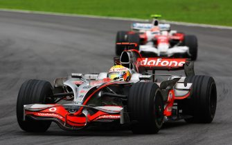 SAO PAULO, BRAZIL - NOVEMBER 02:  Lewis Hamilton of Great Britain and McLaren Mercedes leads from Timo Glock of Germany and Toyota on his way to winning the Formula One World Championship during the Brazilian Formula One Grand Prix at the Interlagos Circuit on November 2, 2008 in Sao Paulo, Brazil.  (Photo by Clive Mason/Getty Images)