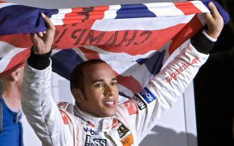British Formula One driver Lewis Hamilton waves his national flag to celebrate after winning the F-1 World Championship on November 2, 2008, at Interlagos race track in Sao Paulo, Brazil. Hamilton was crowned Formula One champion after finishing fifth in the Brazil Grand Prix.   AFP PHOTO / ANTONIO SCORZA (Photo credit should read ANTONIO SCORZA/AFP/Getty Images)