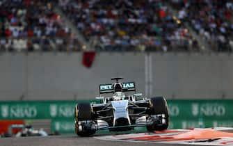 ABU DHABI, UNITED ARAB EMIRATES - NOVEMBER 23:  Lewis Hamilton of Great Britain and Mercedes GP drives during the Abu Dhabi Formula One Grand Prix at Yas Marina Circuit on November 23, 2014 in Abu Dhabi, United Arab Emirates.  (Photo by Clive Mason/Getty Images)