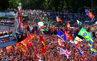 MONZA, ITALY - SEPTEMBER 06:  Lewis Hamilton of Great Britain and Mercedes GP celebrates on the podium next to Sebastian Vettel of Germany and Ferrari after winning the Formula One Grand Prix of Italy at Autodromo di Monza on September 6, 2015 in Monza, Italy.  (Photo by Mark Thompson/Getty Images)