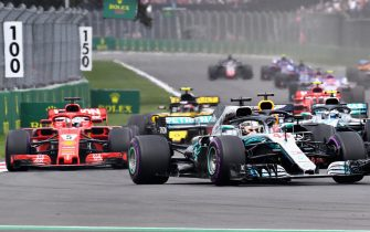 MEXICO CITY, MEXICO - OCTOBER 28: Lewis Hamilton of Great Britain driving the (44) Mercedes AMG Petronas F1 Team Mercedes WO9 leads Sebastian Vettel of Germany driving the (5) Scuderia Ferrari SF71H on track during the Formula One Grand Prix of Mexico at Autodromo Hermanos Rodriguez on October 28, 2018 in Mexico City, Mexico.  (Photo by Clive Mason/Getty Images)