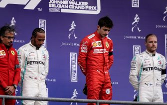 Winner Ferrari's Monegasque driver Charles Leclerc (2R), second placed Mercedes' British driver Lewis Hamilton (2L) and third placed Mercedes' Finnish driver Valtteri Bottas (R) react on the podium after the Belgian Formula One Grand Prix at the Spa-Francorchamps circuit in Spa on September 1, 2019. (Photo by Kenzo TRIBOUILLARD / AFP)        (Photo credit should read KENZO TRIBOUILLARD/AFP/Getty Images)