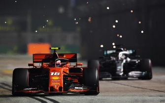 SINGAPORE, SINGAPORE - SEPTEMBER 22: Charles Leclerc of Monaco driving the (16) Scuderia Ferrari SF90 leads Lewis Hamilton of Great Britain driving the (44) Mercedes AMG Petronas F1 Team Mercedes W10 on track during the F1 Grand Prix of Singapore at Marina Bay Street Circuit on September 22, 2019 in Singapore. (Photo by Clive Mason/Getty Images)