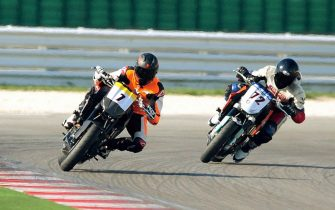 Former seven-time Formula One champion Michael Schumacher (L) competes with his two-wheeled racer on his first official motorcycle race, in Misano on March 30, 2008. Competing in the minor KTM 250 series at the track near Italy's Adriatic coast, Schumacher started on the front row and placed fourth in the race.  AFP PHOTO / STR (Photo credit should read STR/AFP via Getty Images)
