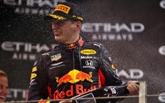 ABU DHABI, UNITED ARAB EMIRATES - DECEMBER 01: Second placed Max Verstappen of Netherlands and Red Bull Racing celebrates on the podium during the F1 Grand Prix of Abu Dhabi at Yas Marina Circuit on December 01, 2019 in Abu Dhabi, United Arab Emirates. (Photo by Dan Istitene/Getty Images)