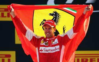MONZA, ITALY - SEPTEMBER 06:  Sebastian Vettel of Germany and Ferrari celebrates on the podium after finishing second in the Formula One Grand Prix of Italy at Autodromo di Monza on September 6, 2015 in Monza, Italy.  (Photo by Bryn Lennon/Getty Images)