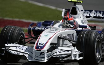 Robert Kubica, BMW Sauber F1.07, Grand Prix of Great Britain, Silverstone Circuit, 08 July 2007. Robert Kubica waves at the crowd during his slowing down after qualifying for the 2007 British Grand Prix. (Photo by Paul-Henri Cahier/Getty Images)