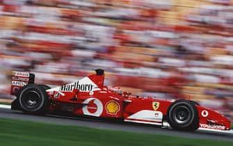 Michael Schumacher of Germany drives the #1 Scuderia Ferrari Marlboro Ferrari F2002 Ferrari V10 to victory in the Formula One German Grand Prix on 28 July 2002 at the Hockenheimring, Hockenheim, Germany.  (Photo by Darren Heath/Getty Images)