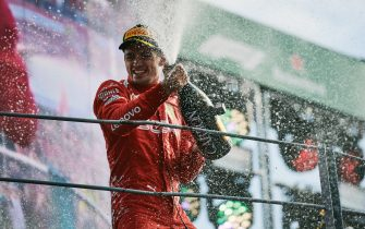 MONZA, ITALY - SEPTEMBER 08: Charles Leclerc of Monaco and Scuderia Ferrari celebrates on the podium after winning the Formula 1 Grand Prix of Italy at Autodromo di Monza on September 8, 2019 in Monza, Italy. (Photo by Guido de Bortoli/Getty Images)