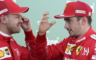 epa07916597 German Formula One driver Sebastian Vettel (L) and Monaco's Formula One driver Charles Leclerc of Scuderia Ferrari chat after the qualifying session of the Japanese Formula One Grand Prix in Suzuka, Japan, 13 October 2019.  EPA/FRANCK ROBICHON