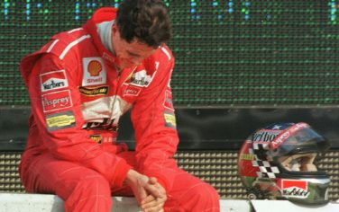 German F1 driver Michael Schumacher of Ferrari looks down in dejection after retiring from the race after the 32nd lap of the Formula One Japanese Grand Prix in Suzuka 01 November.  Competing four-points behind leader and eventual winner Mika Hakkinen of Finland, Schumacher failed in his bid to win the driver's title.  AFP PHOTO (Photo by TORU YAMANAKA / AFP) (Photo by TORU YAMANAKA/AFP via Getty Images)