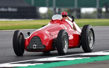 NORTHAMPTON, ENGLAND - JULY 14: Kimi Raikkonen of Finland and Alfa Romeo Racing drives an old Alfa Romeo on track for the drivers parad before the F1 Grand Prix of Great Britain at Silverstone on July 14, 2019 in Northampton, England. (Photo by Dan Istitene/Getty Images)