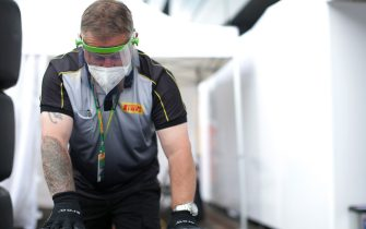 SPIELBERG, AUSTRIA - JULY 03:  A Pirelli tyre technician works on tyres after practice for the F1 Grand Prix of Austria at Red Bull Ring on July 03, 2020 in Spielberg, Austria. (Photo by Peter Fox/Getty Images)