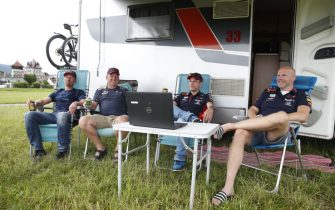 Formula One supporters from Holland gather outside their caravan at a camping before watching the practice sessions on a screen, as the Austrian Formula One Grand Prix takes place without supporters due to the new coronavirus pandemic, on July 3, 2020 in Spielberg, Austria. - Seven months after they last competed in earnest, the Formula One circus will push a post-lockdown re-set button to open the 2020 season in Austria on July 5. (Photo by ERWIN SCHERIAU / APA / AFP) / Austria OUT (Photo by ERWIN SCHERIAU/APA/AFP via Getty Images)