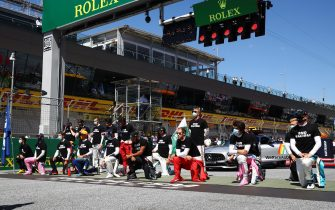 SPIELBERG, AUSTRIA - JULY 05: Some of the F1 drivers take a knee on the grid in support of the Black Lives Matter movement ahead of the Formula One Grand Prix of Austria at Red Bull Ring on July 05, 2020 in Spielberg, Austria. (Photo by Mark Thompson/Getty Images)