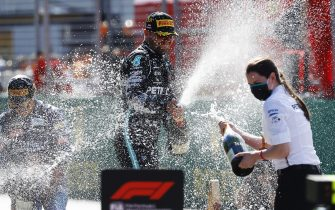 SPIELBERG, AUSTRIA - JULY 05:  Race winner Valtteri Bottas of Finland and Mercedes GP celebrates on the podium during the Formula One Grand Prix of Austria at Red Bull Ring on July 05, 2020 in Spielberg, Austria. (Photo by Leonhard Foeger/Pool via Getty Images)