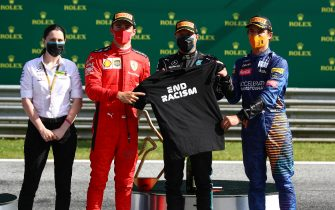 SPIELBERG, AUSTRIA - JULY 05: Race winner Valtteri Bottas of Finland and Mercedes GP, second placed Charles Leclerc of Monaco and Ferrari and third placed Lando Norris of Great Britain and McLaren F1 pose with an End Racism shirt during the Formula One Grand Prix of Austria at Red Bull Ring on July 05, 2020 in Spielberg, Austria. (Photo by Mark Thompson/Getty Images)
