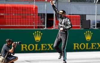 Mercedes' Finnish driver Valtteri Bottas celebrates winning the Austrian Formula One Grand Prix race on July 5, 2020 in Spielberg, Austria. (Photo by LEONHARD FOEGER / POOL / AFP) (Photo by LEONHARD FOEGER/POOL/AFP via Getty Images)