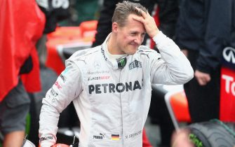 SAO PAULO, BRAZIL - NOVEMBER 25:  Michael Schumacher of Germany and Mercedes GP reacts in parc ferme after finishing his last F1 race following the Brazilian Formula One Grand Prix at the Autodromo Jose Carlos Pace on November 25, 2012 in Sao Paulo, Brazil.  (Photo by Clive Mason/Getty Images)