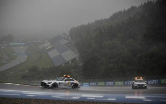 RED BULL RING, AUSTRIA - JULY 11: Safety Car and Medical Car drives around in heavy rain during the Styrian GP at Red Bull Ring on Saturday July 11, 2020 in Spielberg, Austria. (Photo by Charles Coates / LAT Images)