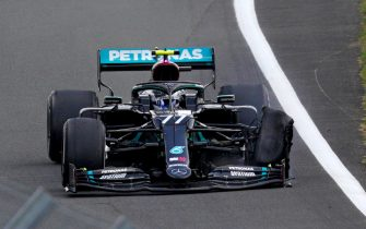 Mercedes' Finnish driver Valtteri Bottas drives with a puncture during the Formula One British Grand Prix at the Silverstone motor racing circuit in Silverstone, central England on August 2, 2020. (Photo by Will Oliver / POOL / AFP) (Photo by WILL OLIVER/POOL/AFP via Getty Images)