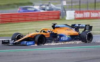 NORTHAMPTON, ENGLAND - AUGUST 02: Carlos Sainz of Spain driving the (55) McLaren F1 Team MCL35 Renault on track with a punctured tyre during the F1 Grand Prix of Great Britain at Silverstone on August 02, 2020 in Northampton, England. (Photo by Andrew Boyers/Pool via Getty Images)
