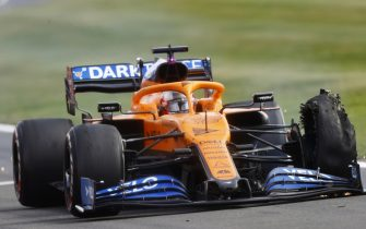 SILVERSTONE, UNITED KINGDOM - AUGUST 02: Carlos Sainz, McLaren MCL35, pits with a puncture during the British GP at Silverstone on Sunday August 02, 2020 in Northamptonshire, United Kingdom. (Photo by Andy Hone / LAT Images)