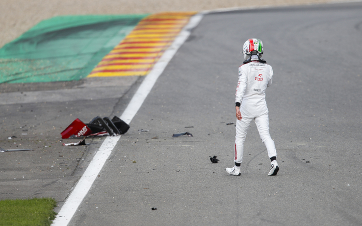 SPA-FRANCORCHAMPS, BELGIUM - AUGUST 30: Antonio Giovinazzi, Alfa Romeo, walks past the debris of his car on track after a collision during the Belgian GP at Spa-Francorchamps on Sunday August 30, 2020 in Spa, Belgium. (Photo by Zak Mauger / LAT Images)