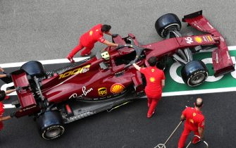 MUGELLO CIRCUIT, ITALY - SEPTEMBER 10: Mechanics push the Charles Leclerc Ferrari SF1000 in the pit lane during the Tuscany GP at Mugello Circuit on Thursday September 10, 2020, Italy. (Photo by Charles Coates / LAT Images)