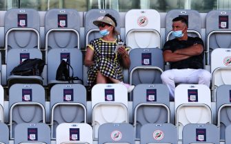 SOCHI, RUSSIA - SEPTEMBER 25: Fans watch the action during practice ahead of the F1 Grand Prix of Russia at Sochi Autodrom on September 25, 2020 in Sochi, Russia. (Photo by Mark Thompson/Getty Images)
