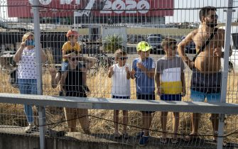 SOCHI, RUSSIA - SEPTEMBER 25: Fans watch the action during practice ahead of the F1 Grand Prix of Russia at Sochi Autodrom on September 25, 2020 in Sochi, Russia. (Photo by Pavel Golovkin - Pool/2020 Getty Images)
