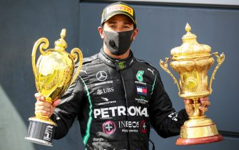 SILVERSTONE, UNITED KINGDOM - AUGUST 02: Race Winner Lewis Hamilton, Mercedes-AMG Petronas F1 with the trophies on the podium during the British GP at Silverstone on Sunday August 02, 2020 in Northamptonshire, United Kingdom. (Photo by Steven Tee / LAT Images)