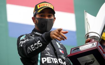 SPA-FRANCORCHAMPS, BELGIUM - AUGUST 30: Race Winner Lewis Hamilton, Mercedes-AMG Petronas F1 celebrates on the podium with the trophy during the Belgian GP at Spa-Francorchamps on Sunday August 30, 2020 in Spa, Belgium. (Photo by Zak Mauger / LAT Images)