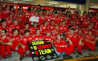 Ferrari celebrate their race victory, constructors' title  and a sixth world drivers' championship (L to R): Rubens Barrichello (BRA) Ferrari; Michael Schumacher (GER) Ferrari; Jean Todt (FRA) Ferrari Sporting Director; Corinna Schumacher (GER); Ross Brawn (GBR) Ferrari Technical Director. Formula One World Championship, Rd16, Japanese Grand Prix, Suzuka , Japan, 12 October 2003. DIGITAL IMAGE